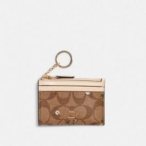 Coach floral  Skinny Id Case In Signature Canvas